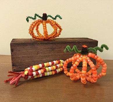 bead pumpkin and Indian corn